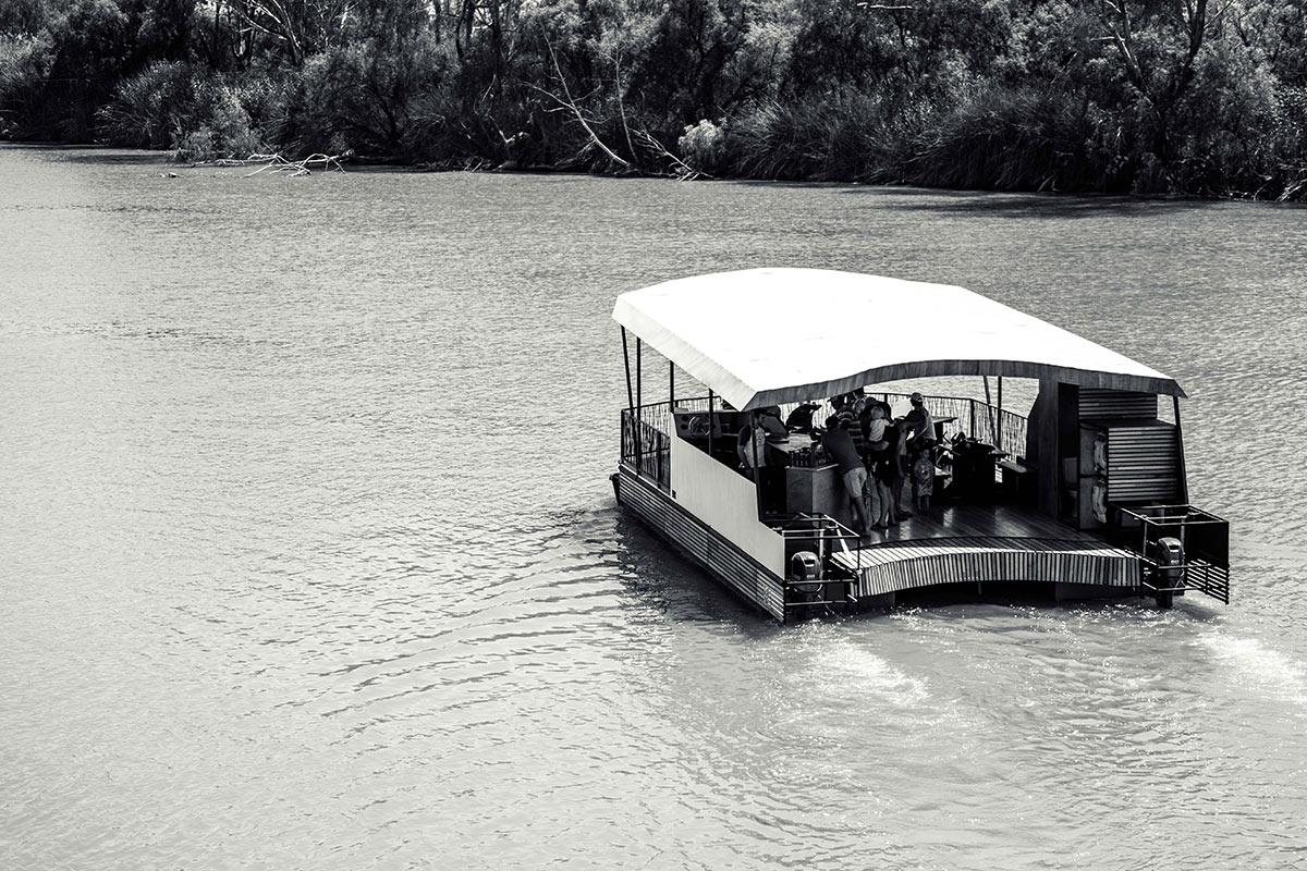 natura barge cruising along the river